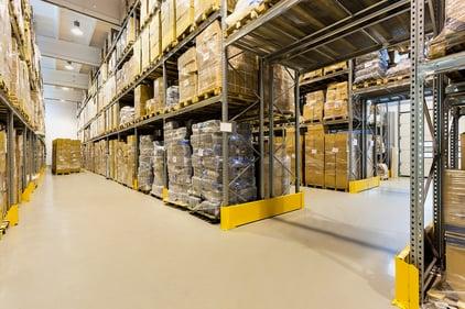 Interior of a huge spacious warehouse with carton boxes